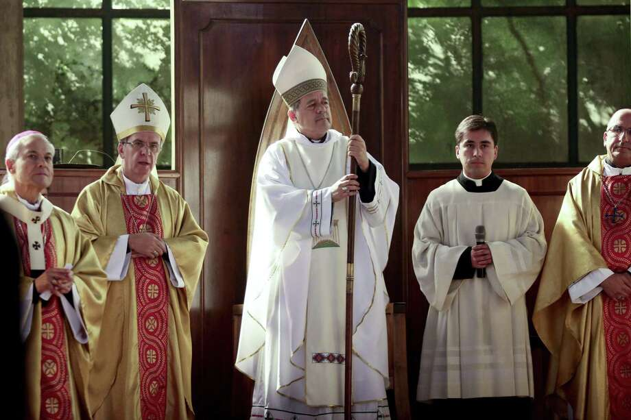 FILE -- In this  March 21, 2015 file photo, Rev. Juan Barros, center, stands as he attends his ordination ceremony as bishop in Osorno, southern Chile. Four members of Pope Francis' sex abuse advisory commission headed to Rome on Sunday, April 12, 2015 to voice their concerns in person about Francis' appointment of a Chilean bishop accused of covering up for the country's most notorious molester. (AP Photo/Mario Mendoza Cabrera, File) CHILE OUT - NO USAR EN CHILE Photo: AP / AP