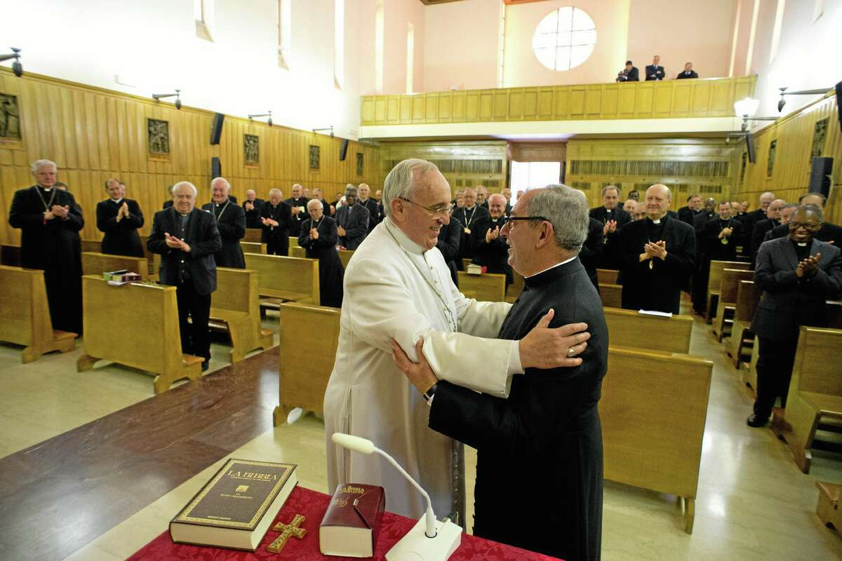 In this picture made available by the Vatican newspaper L'Osservatore Romano, Pope Francis, greets Monsignor Angelo De Donatis at the end of his retreat for spiritual exercises, in Ariccia, Italy, Friday, March 14, 2014. Francis and the heads of Vatican offices traveled to Ariccia, in the hills south of Rome, where the Society of St. Paul offered up a retreat house for spiritual exercises through Friday. Jesuits typically do such Lenten retreats away from home, and Francis is breaking with recent papal tradition of prayers and meditation at the Vatican during the 40-day Lenten period preceding Easter. (AP Photo/L'Osservatore Romano)