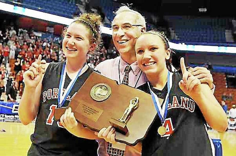 Portland girls basketball coach Nick Chaconis and players Kelly Coleman, left, and Lindsey Dionne celebrate the Highlanders' 2011 Class S state championship victory over Cromwell at the Mohegan Sun Arena. Photo: Catherine Avalone – The Middletown Press