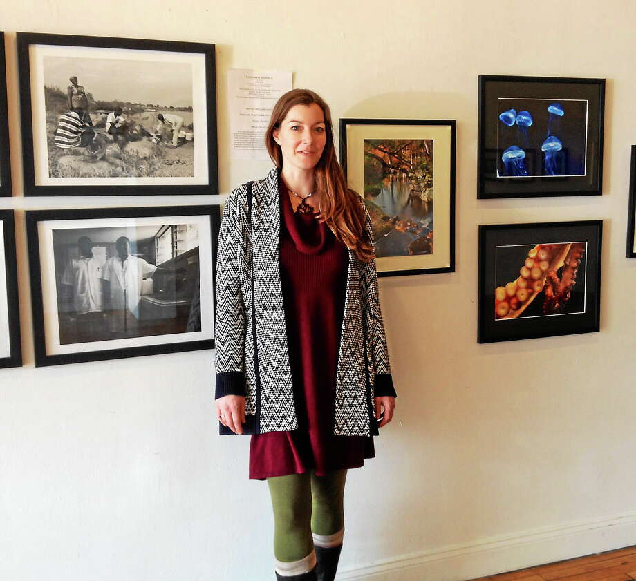 Passionate Waters II will celebrate World Water Day March 22 at the MAC 650 Gallery on Main Street in Middletown with pieces by more than a dozen local artists. Proceeds benefit the Connecticut Watershed Council's Source to Sea Cleanup. Here, co-organizer Carolyn Reeves shows off some of the work. Photo: Cassandra Day — The Middletown Press