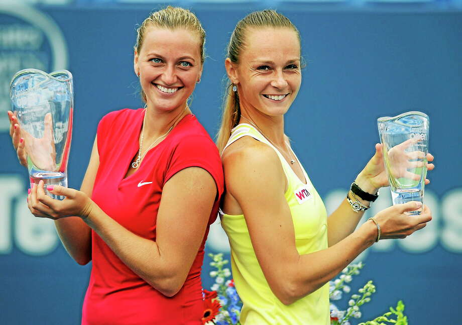 No. 2 Petra Kvitova, left, defeated Magdalena Rybarikova on Saturday to win her second Connecticut Open tournament title in the last three years. Photo: Bob Child — For The Register