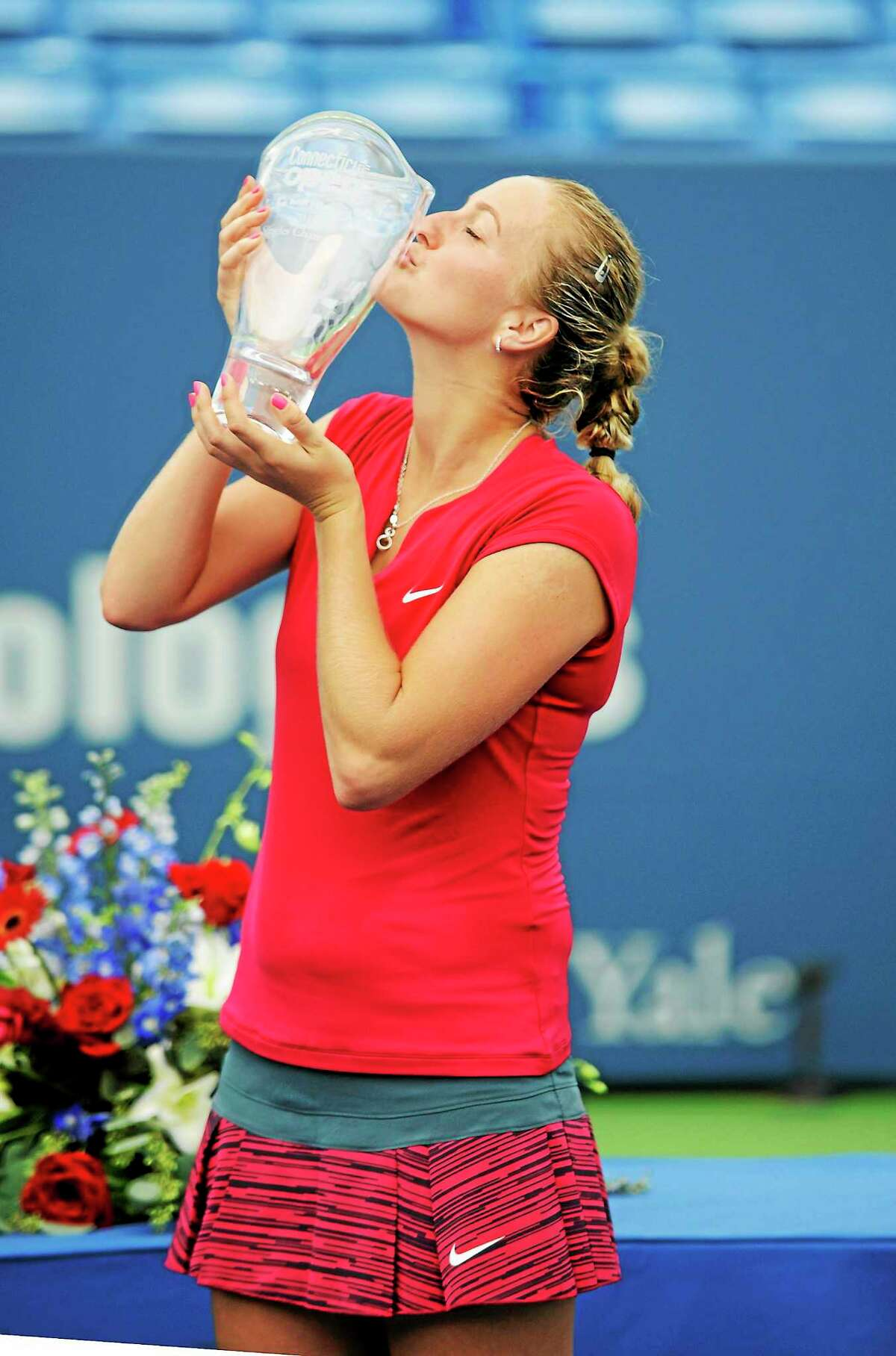 Petra Kvitova kisses the trophy after winning the Connecticut Open on Saturday.