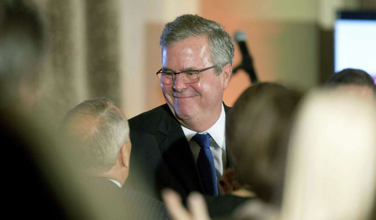 Former Florida Gov. Jeb Bush talks to supporters after speaking at the U.S. Cuba Democracy PAC's 11th Annual Luncheon in Coral Gables, Fla. on Dec. 2, 2014.