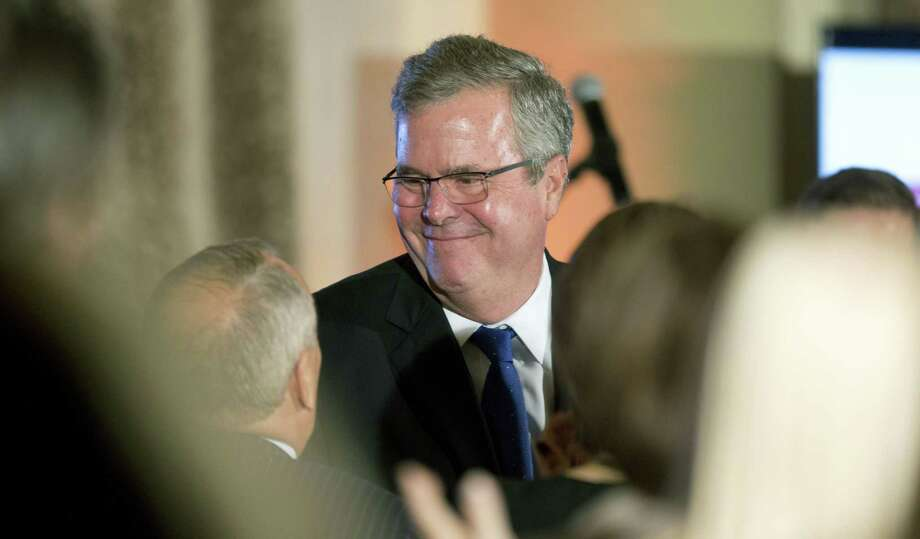 Former Florida Gov. Jeb Bush talks to supporters after speaking at the U.S. Cuba Democracy PAC's 11th Annual Luncheon in Coral Gables, Fla. on Dec. 2, 2014. Photo: AP Photo/J Pat Carter  / AP