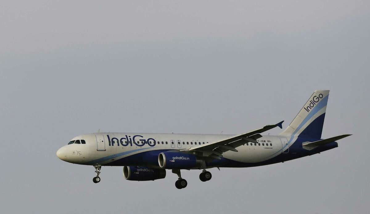 FILE- This April 16, 2015 file photo shows an India's budget airline IndiGo aircraft approaching for landing at the Indira Gandhi International (IGI) airport in New Delhi, India. Indian budget airline IndiGo finalized an exceptionally large order for 250 single-aisle Airbus A320neo jets on Monday, Aug. 17, 2015 to keep up with rapid growth in the country's air travel.