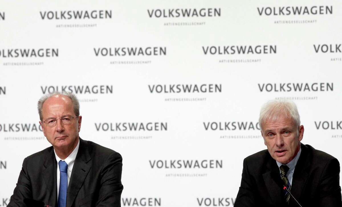 Hans Dieter Poetsch, chairman of the board of directors of Volkswagen, left, and Matthias Mueller, CEO of Volkswagen, right, address the media during a press conference of the German car manufacturer Volkswagen in Wolfsburg, Germany on Dec. 10, 2015.