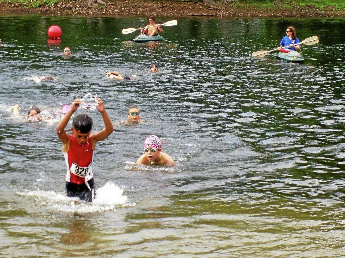 Kids compete in a Middlesex YMCA triathlon.