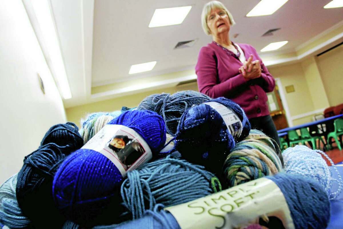 Library Assistant Director Cyndi Shirshac displays a portion of colorful yarns at the Durham Public Library for its first craft swap on Saturday. The event kicks off Money Smart Week through April 24.