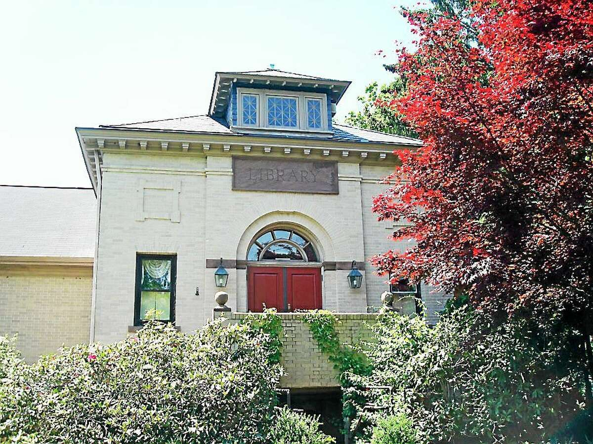 The Durham Public Library is at 7 Maple Avenue, which is directly off Main near Town Hall.