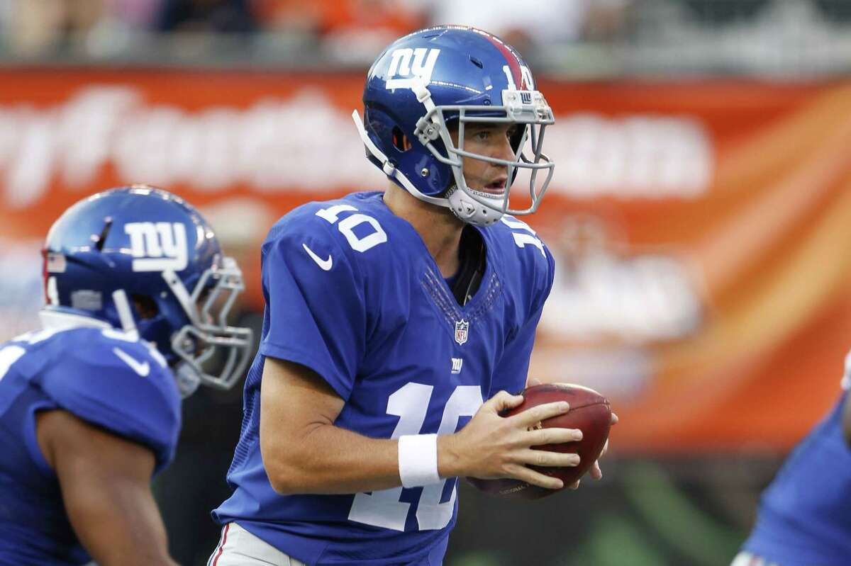 New York Giants quarterback Eli Manning takes a snap in the first half of Friday's preseason game against the Bengals in Cincinnati.