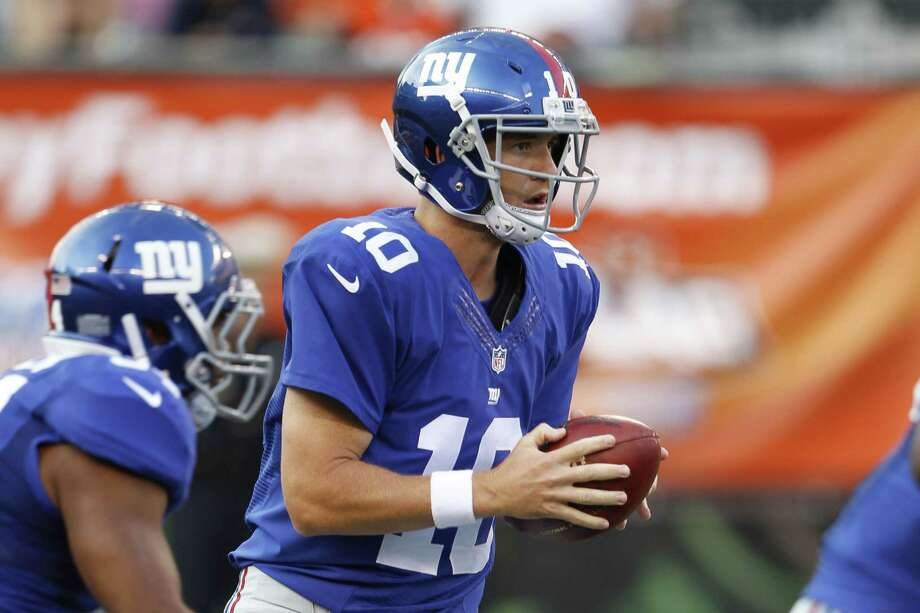 New York Giants quarterback Eli Manning takes a snap in the first half of Friday's preseason game against the Bengals in Cincinnati. Photo: Frank Victores — The Associated Press  / FR170726 AP