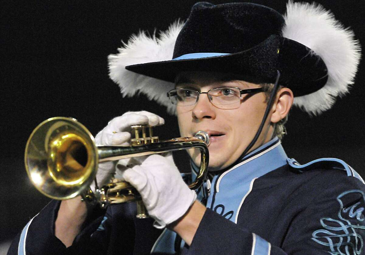 Trumpet player, Matt Dagenais, a member of the Middletown High School Marching Band plays during the half time show at the Rosek-Skubel Stadium in Middletown. Catherine Avalone - The Middletown Press