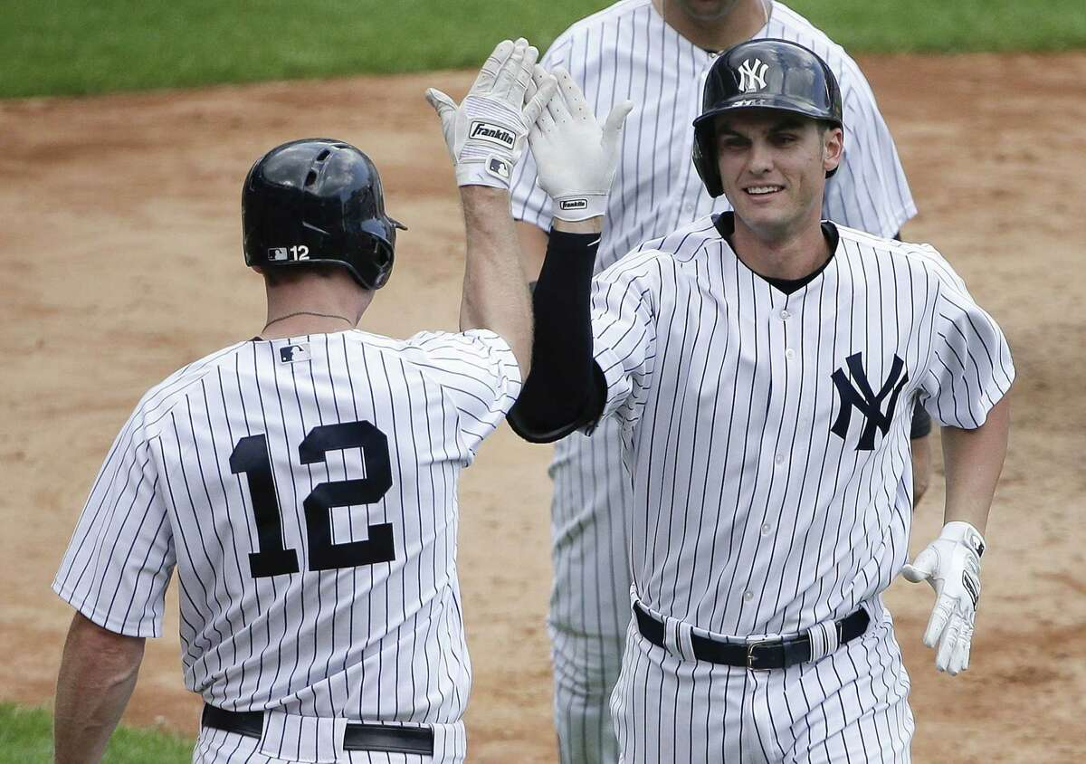 Yankees rookie Greg Bird, right, is greeted by Chase Headley (12) after hitting a two-run home run against the Minnesota Twins during the sixth inning of Wednesday's 4-3 win in New York.