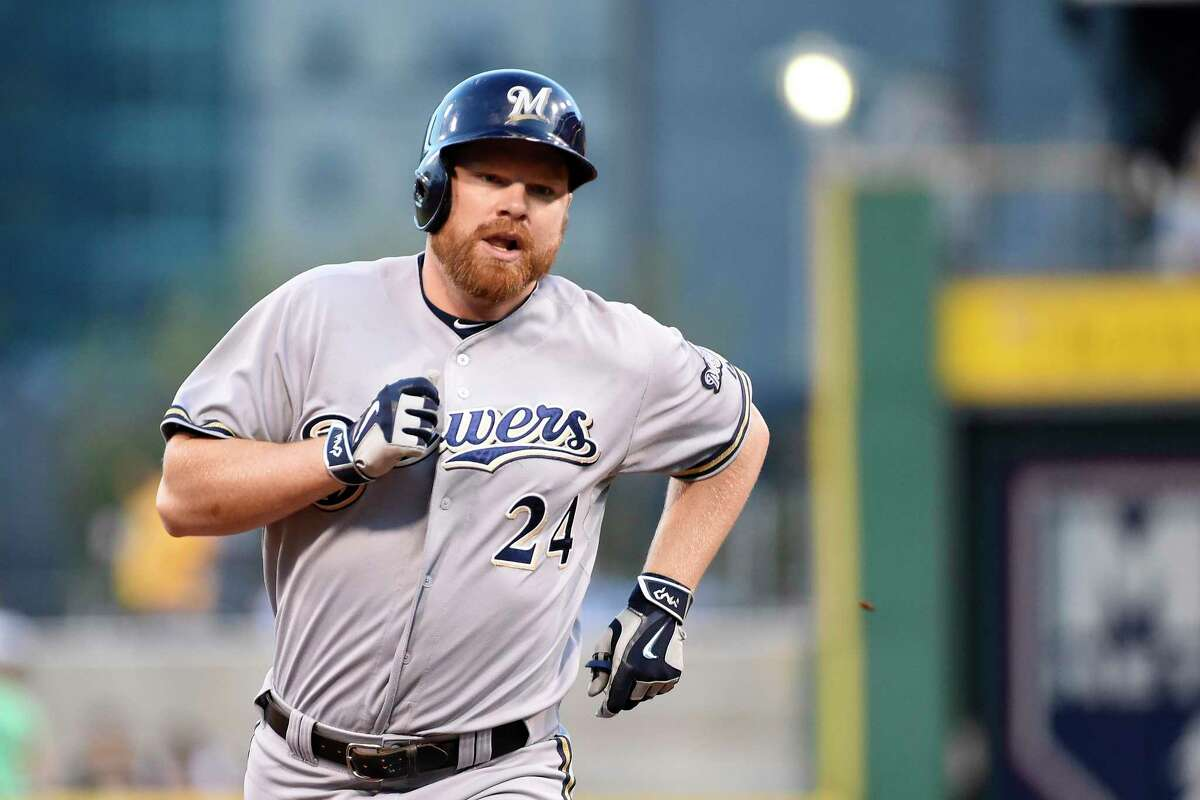 The busy Seattle Mariners have acquired first baseman Adam Lind from the Milwaukee Brewers for three young minor league pitchers.