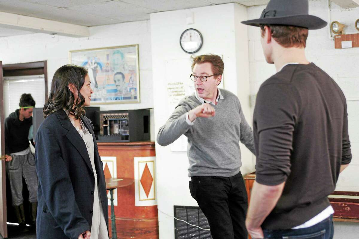 """Don Stephenson, center, leads rehearsal with Manna Nichols, who plays Sarah, and Tony Roach, who play Sky Masterson, in """"Guys and Dolls."""""""