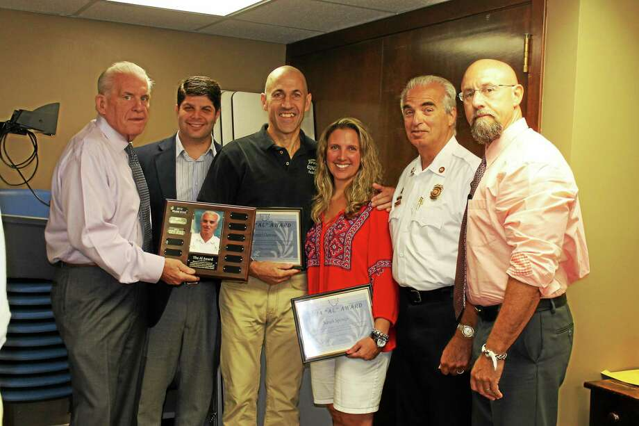 Daniel Ostrow and Sarah Sponzo of Tat Wong Kung Fu Academy are the recipients of the 2014 Al Award at the Middlesex Chamber's Central Business Bureau August meeting. From left are: Chamber President Larry McHugh, Mayor Dan Drew, Ostrow, Sponzo, Middletown Fire Marshal Al Santostefano and Chamber CBB Chairman Phil Ouellette. Photo: Courtesy Photo