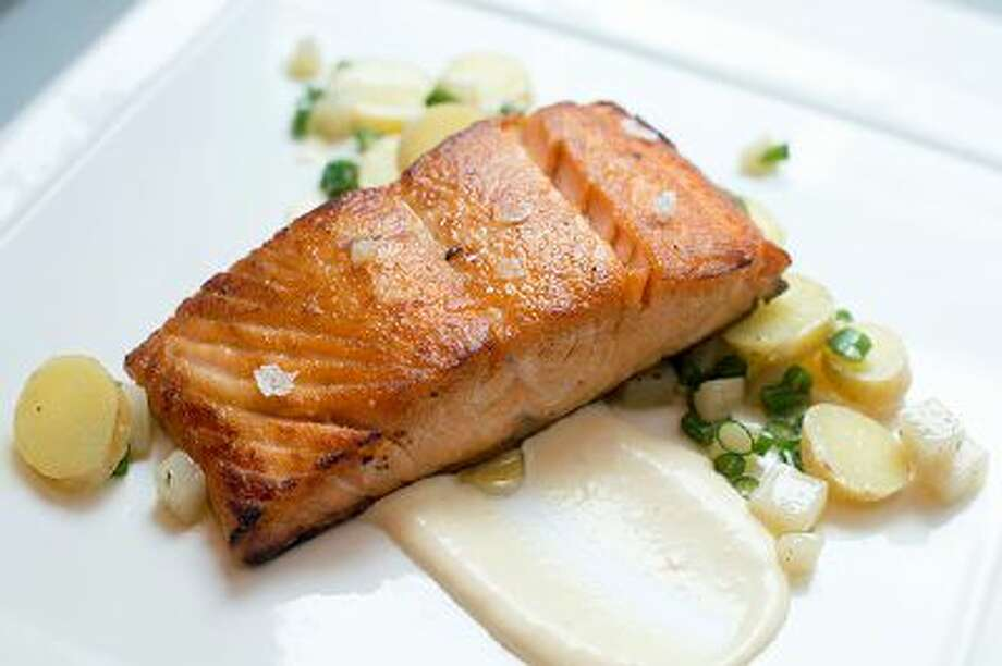 Roasted Verlasso Salmon With Warm Potato-Sunchoke Salad. The components on the plate provide subtle color and texture. Illustrates SUPERFOODS (category d), by Bonnie S. Benwick (c) 2014, The Washington Post. Moved Monday, March 10, 2014. (MUST CREDIT: Washington Post photo by Marvin Joseph) Photo: The Washington Post / THE WASHINGTON POST