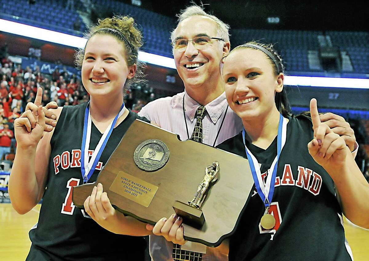(Catherine Avalone/The Middletown Press) File photo Portland High School head basketball coach Nick Chaconis with Highlander senior co-captains Kelly Coleman, left, and Lindsey Dionne, right, following their Class S championship win over the Cromwell Panthers at Mohegan Sun Arena in Uncasville on March 10, 2011.