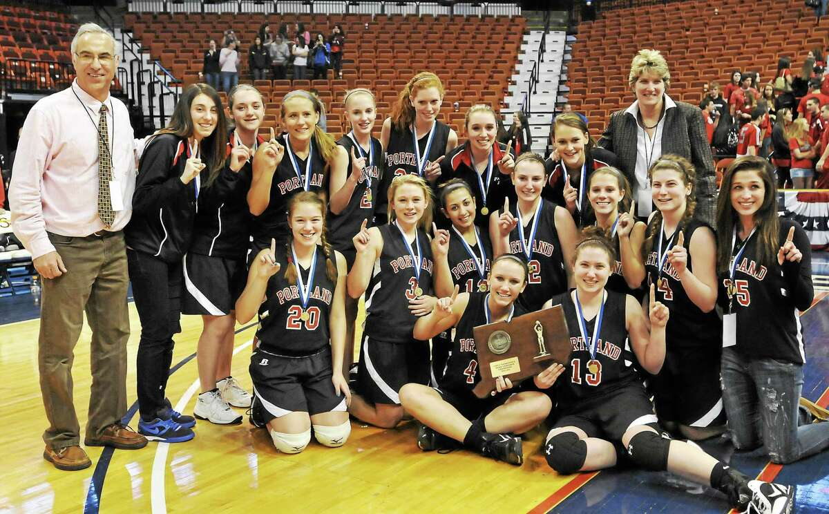(Catherine Avalone/The Middletown Press) File photo Portland High School head basketball coach Nick Chaconis, at far left with the Portland High School girls basketball team on March 10, 2011 after clinching the CIAC Class S championship game at Mohegan Sun Arena in Uncasville defeating the Cromwell Panthers 45-41 Friday night.