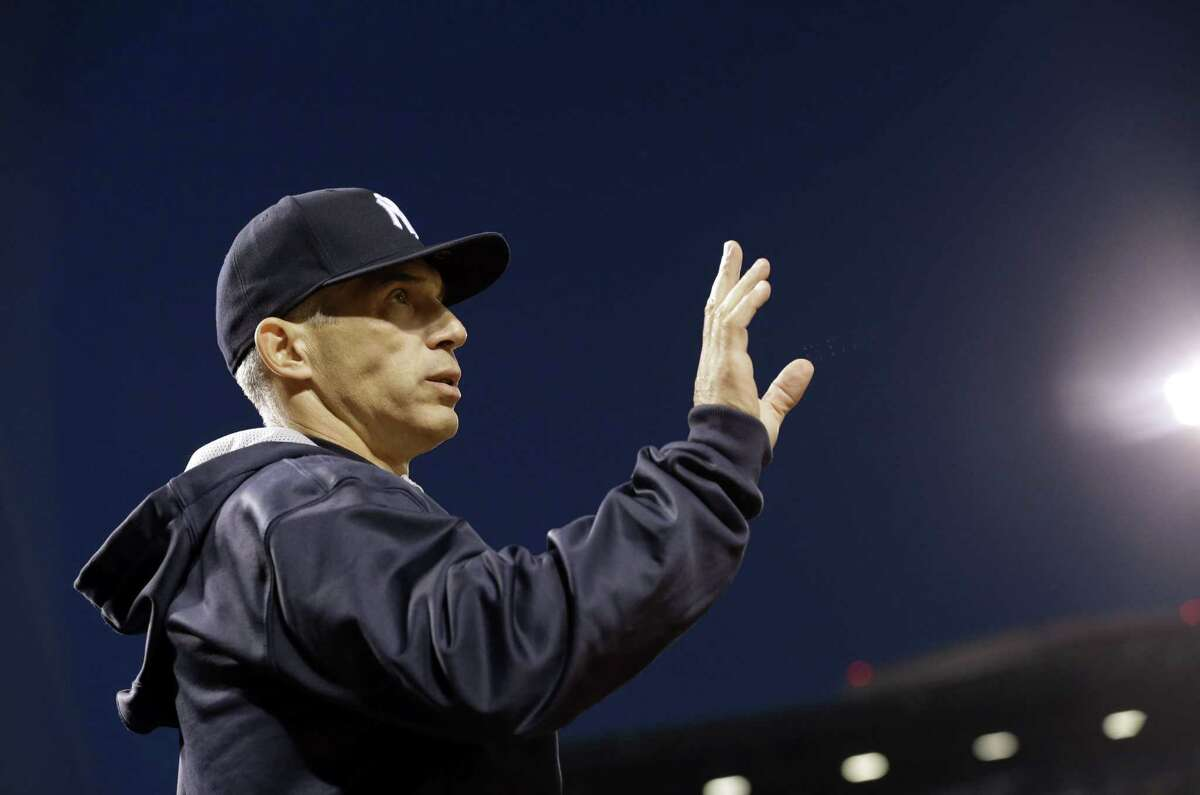 New York Yankees manager Joe Girardi tries to get an umpire's attention from the dugout during Monday's game against the Orioles in Baltimore.