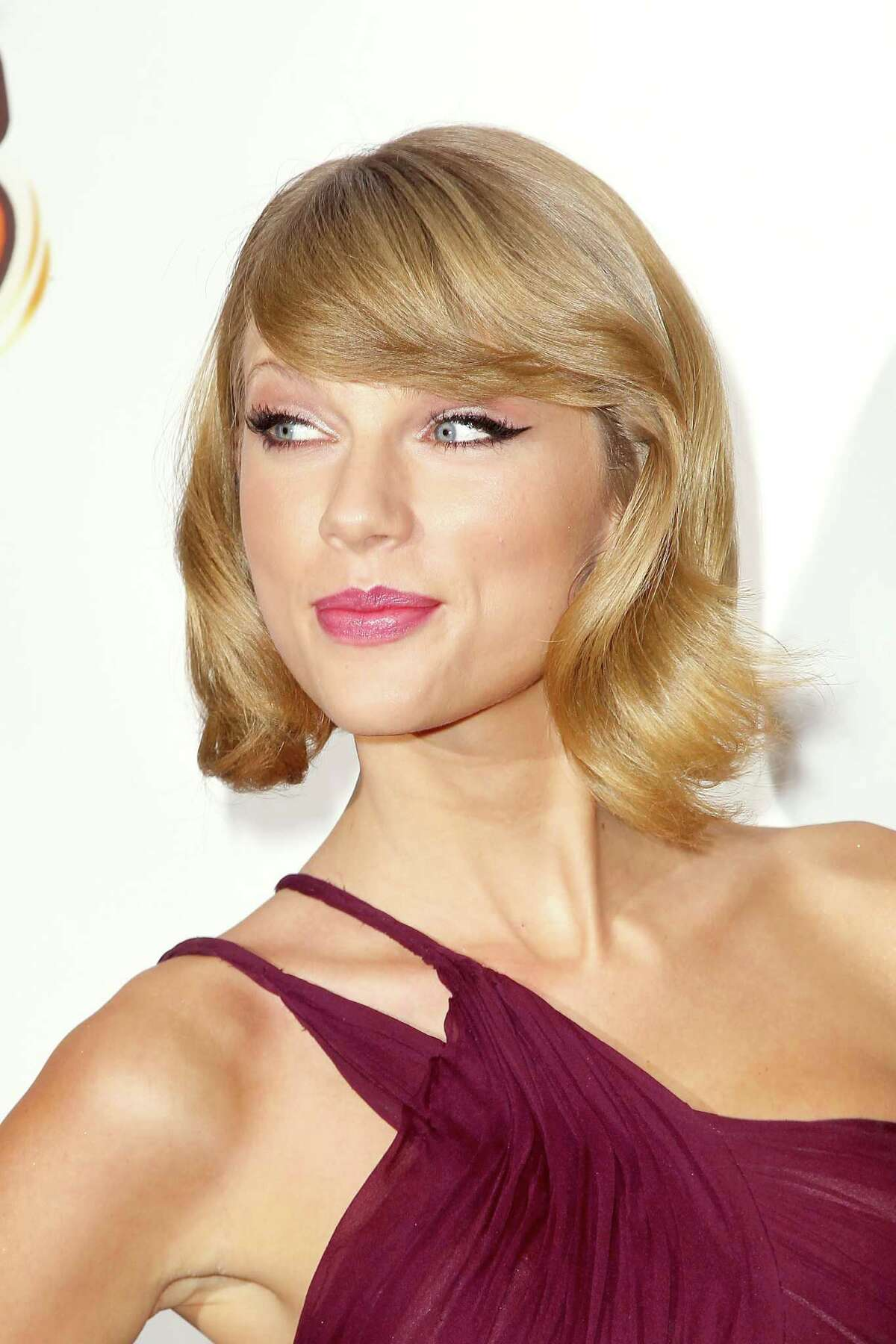In this image released by Starpix, Taylor Swift attends the Z100's Jingle Ball 2014 at Madison Square Garden, Friday, Dec. 12, 2014 in New York. (AP Photo/Starpix, Aurora Rose)