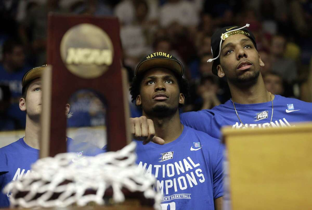 Duke's Grayson Allen, left, Justise Winslow, center, and Jahlil Okafor watch a video during a homecoming celebration for the national champions at Cameron Indoor Stadium on April 7 in Durham, N.C.