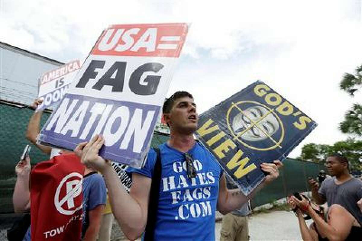Members of the Westboro Baptist Church of Topeka, Kan., demonstrate, Tuesday, Aug. 28, 2012, in Tampa, Fla. Protestors gathered in Tampa to march in demonstration against the Republican National Convention. (AP Photo/Chris O'Meara)
