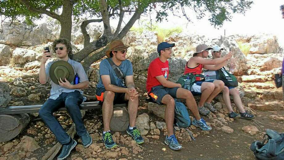 In this July 4, 2014 photo provided by Michigan State University, students in the school's Summer Study Abroad Program take a break after hiking on Mount Arbel in Israel. Some U.S. colleges have now pulled students from their overseas study programs in Israel as the Gaza war rages. Colleges site security as the top concern. (AP Photo/Michigan State University, Becca Rosenblatt) Photo: AP / Michigan State University