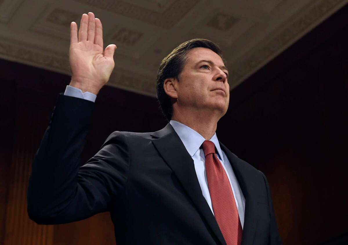 FBI Director James Comey is sworn in on Capitol Hill in Washington, Wednesday, Dec. 9, 2015, prior to testifying before the Senate Judiciary Committee. Comey said the two San Bernardino shooters were radicalized at least two years ago and had discussed jihad and martyrdom as early as 2013.