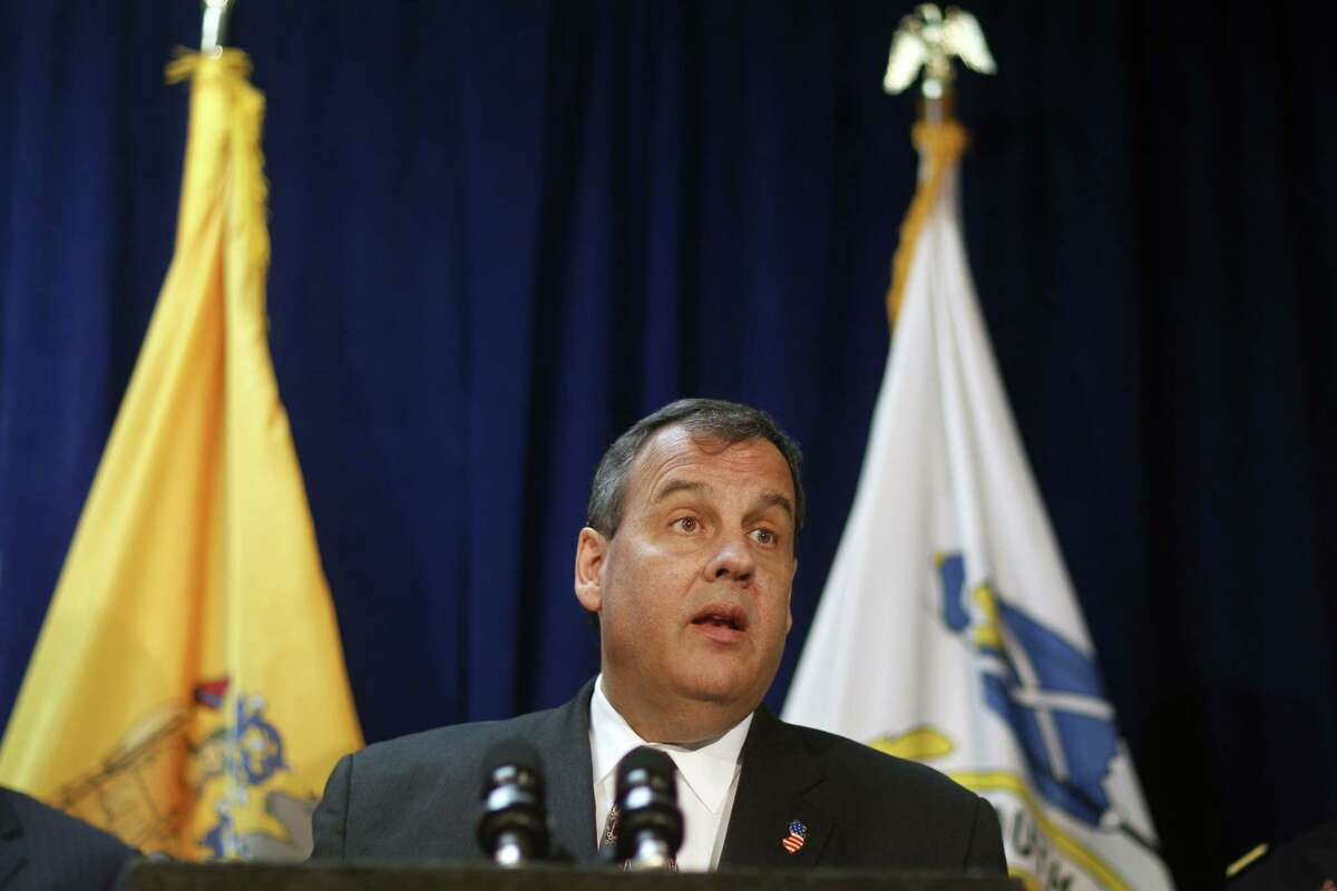 In this April 8, 2015 photo, New Jersey Gov. Chris Christie addresses a gathering as he announces a $202 million flood control project for Union Beach in Union Beach, N.J.