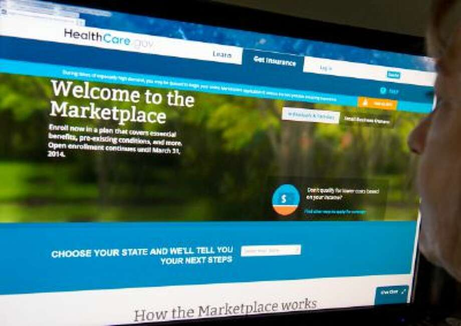 """This December 2, 2013 photo shows a woman reading the HealthCare.gov insurance marketplace internet site in Washington, DC. The troubleshooter appointed by President Barack Obama to overhaul a bungled health care website rollout said Sunday that improvements had made a """"night and day"""" difference in handling online traffic. The White House has admitted previously that the launch of Healthcare.gov, where people can sign up for health insurance, was a debacle and the Obama administration pledged that the vast majority of potential customers would be able to enroll online by the end of November. AFP PHOTO / Karen BLEIER        (Photo credit should read KAREN BLEIER/AFP/Getty Images) Photo: AFP/Getty Images / 2013 AFP"""