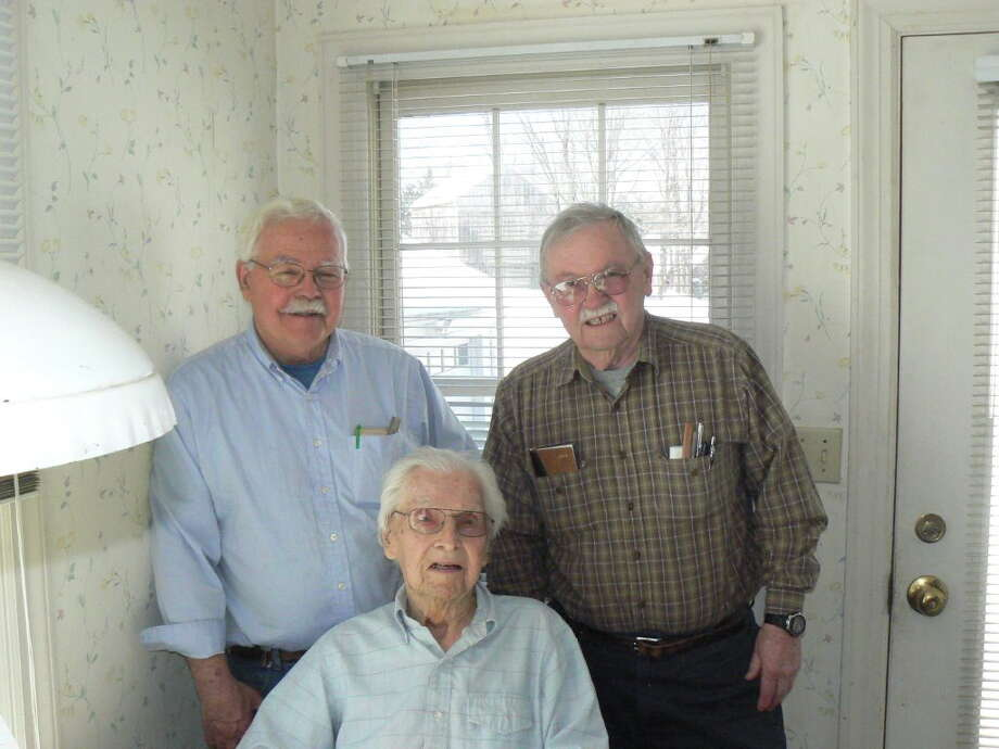 Courtesy Roberts family From left, Earle Roberts Jr., Earle Roberts Sr., and Raymond Roberts of Middletown celebrated the elder Roberts' 100th birthday last month. Photo: Journal Register Co.