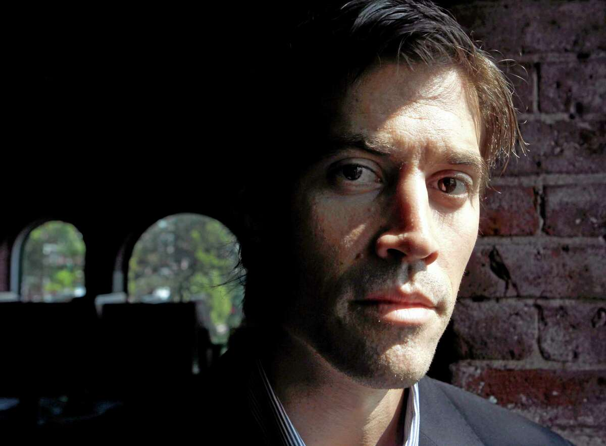 FILE - In this May 27, 2011, file photo shows American Journalist James Foley, of Rochester, N.H., as he poses for a photo in Boston. The beheading of Foley has forced a new debate over how the United States balances its unyielding policy against paying ransom to terrorist groups and saving the lives of Americans being held hostage by some of the worldís most dangerous extremists. (AP Photo/Steven Senne, File)