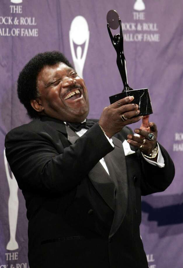 """FILE - In this March 14, 2005 file photo, Percy Sledge holds up a trophy back stage after being inducted into the Rock and Roll Hall of Fame at an induction ceremony in New York. Sledge, who recorded the classic 1966 soul ballad """"When a Man Loves a Woman,"""" died, Tuesday April 14, 2015. He was 74.  (AP Photo/Ed Betz, File) Photo: AP / AP"""