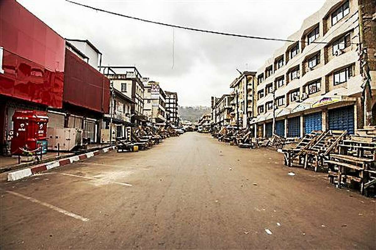 FILE - In this file photo dated Friday, March. 27, 2015, a usually busy street is deserted as Sierra Leone enters a three day country wide lockdown on movement of people due to the Ebola virus in the city of Freetown, Sierra Leone. Sierra Leone's 6 million people were told to stay home for three days, except for religious services, beginning Friday as the West African nation attempted a final push to rid itself of Ebola.