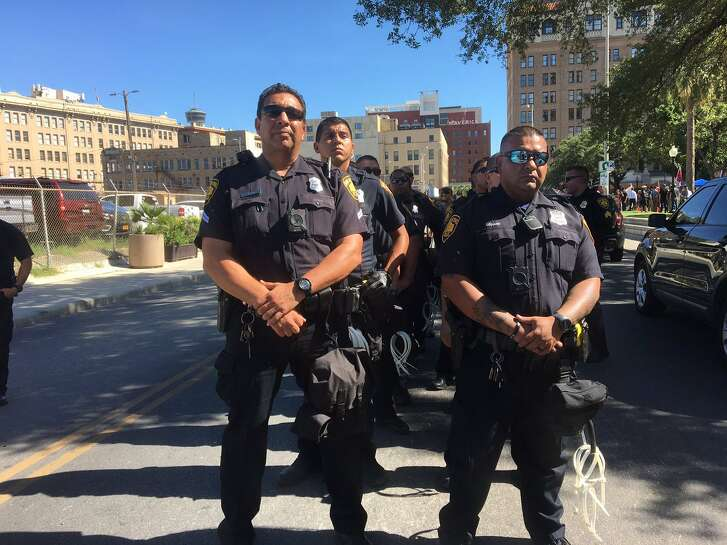 SAPD officers stand ready during a pair of rallies in Travis Park Saturday, Aug. 12, 2017.