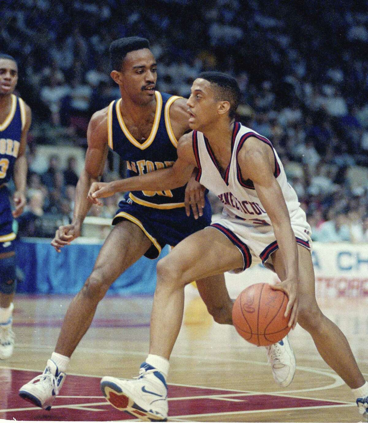 Tate George (right) during the 1990 NCAA tournament.