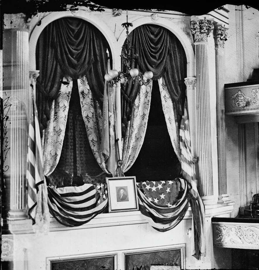 """This April 1865 photo provided by the Library of Congress shows President Abraham Lincoln's box at Ford's Theater, the site of his assassination. Under the headline """"Great National Calamity!"""" the AP reported Lincolnís assassination, on April 15, 1865. Photo: Associated Press  / Library of Congress"""