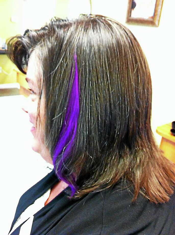 Patty O'Brian, north central regional director of the Connecticut Alzheimer's Association, gets purple extensions placed in her hair to raise money for charity. Photo: Courtesy Photo