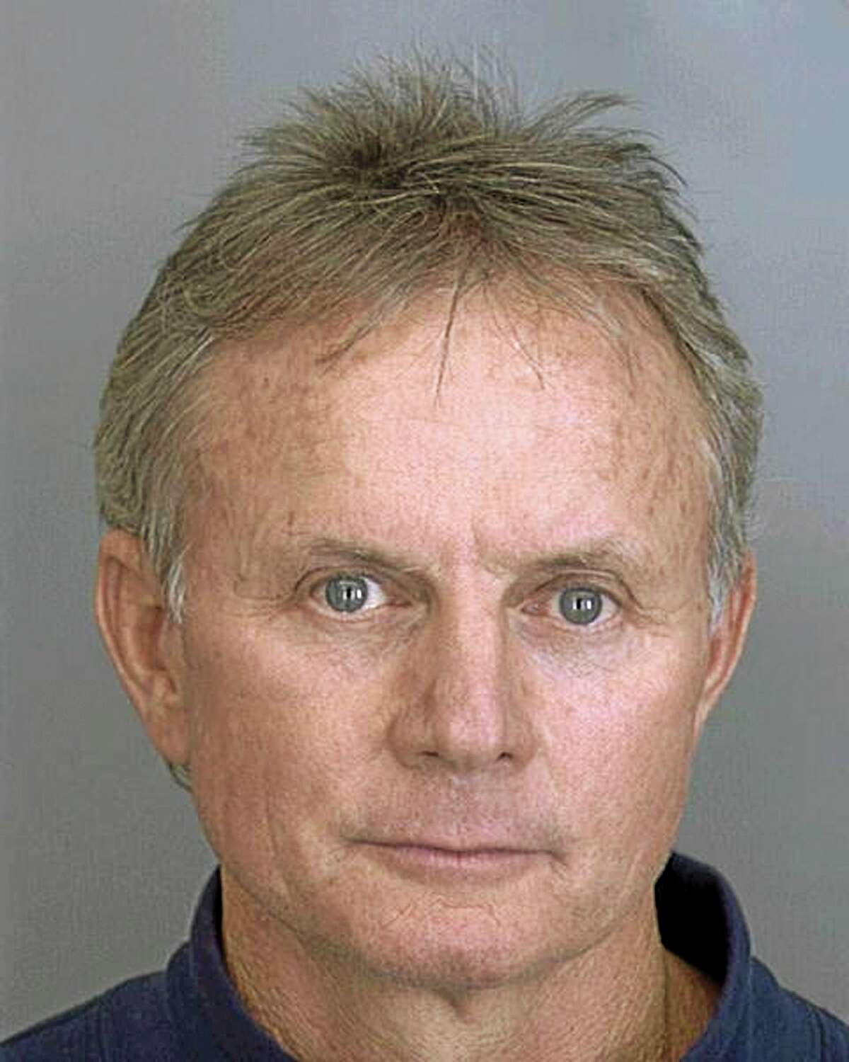FILE - This Nov. 2, 2001 booking file photo, provided by the Dallas County Sheriff's Department show Dr. Wayne Scott Harrington, a Tulsa, Okla., dentist. The oral surgeon whose filthy clinics led to the testing of thousands of patients for HIV and hepatitis permanently surrendered his professional license on Friday, Aug. 22, 2014. (AP Photo/Dallas County Sheriff Department, File)