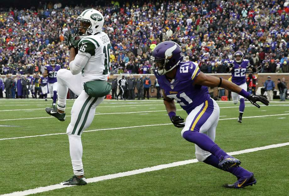 New York Jets receiver Percy Harvin catches a 35-yard touchdown pass in front of Minnesota Vikings cornerback Josh Robinson during Sunday's game in Minneapolis. Photo: Alex Brandon — The Associated Press  / AP
