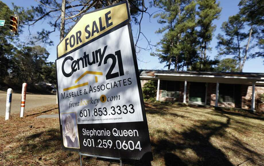 In this Jan. 8 file photo, a realty sign is posted in front of a home for sale in Jackson, Miss. Photo: AP File Photo  / AP