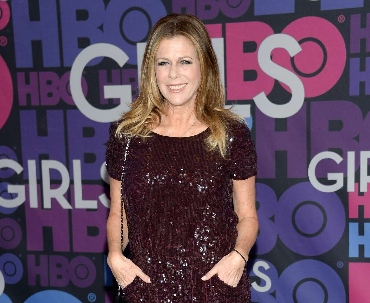 """FILE - In this Jan. 5, 2015 file photo, Rita Wilson attends the premiere of HBO's """"Girls"""" fourth season at The American Museum of Natural History in New York. Wilson is recovering after undergoing a bilateral mastectomy for breast cancer. The 58-year-old actress and singer, who had been appearing in Larry David's play """"Fish in the Dark"""" on Broadway, will return May 5, according to her publicist, Heidi Schaeffer."""