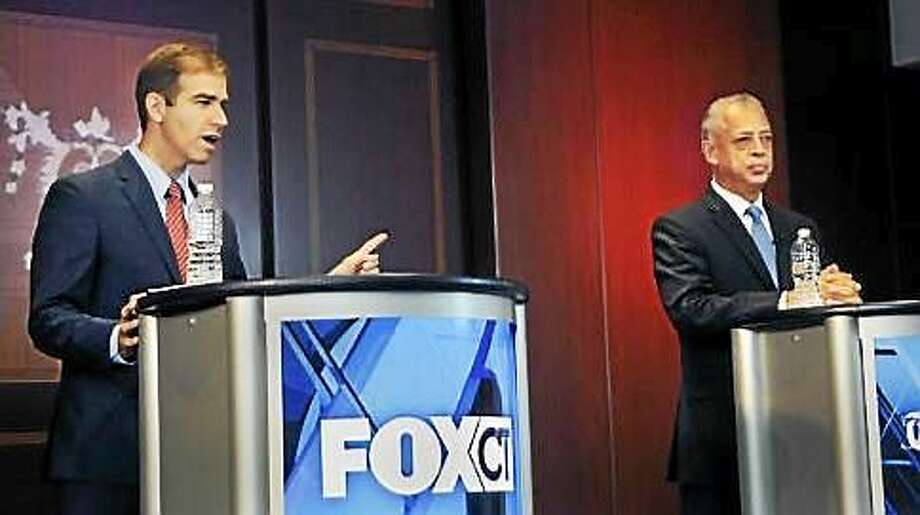 Luke Bronin and Hartford Mayor Pedro Segarra square off at debate hosted by Courant and Fox 61 Photo: Stephan Dunn Photo