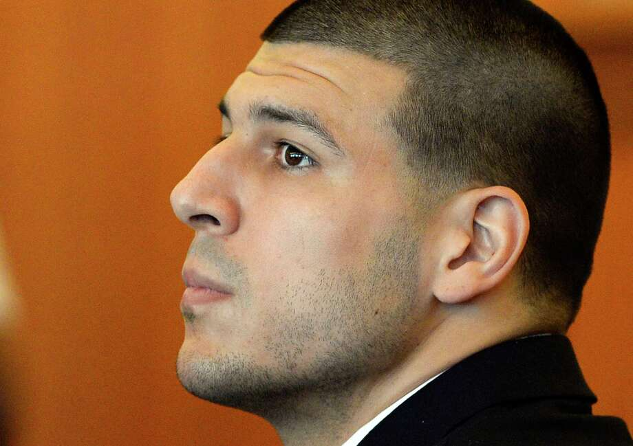 FILE - In this Tuesday, July 22, 2014, file photo, former NFL football player Aaron Hernandez watches during a hearing in Bristol County Superior Court, in Fall River, Mass. A judge is hearing arguments, Tuesday, Sept. 30, 2014, on a bid by Hernandez's lawyers to have additional evidence in a murder case against him thrown out. (AP Photo/CJ Gunther, Pool, File) Photo: AP / Pool EPA