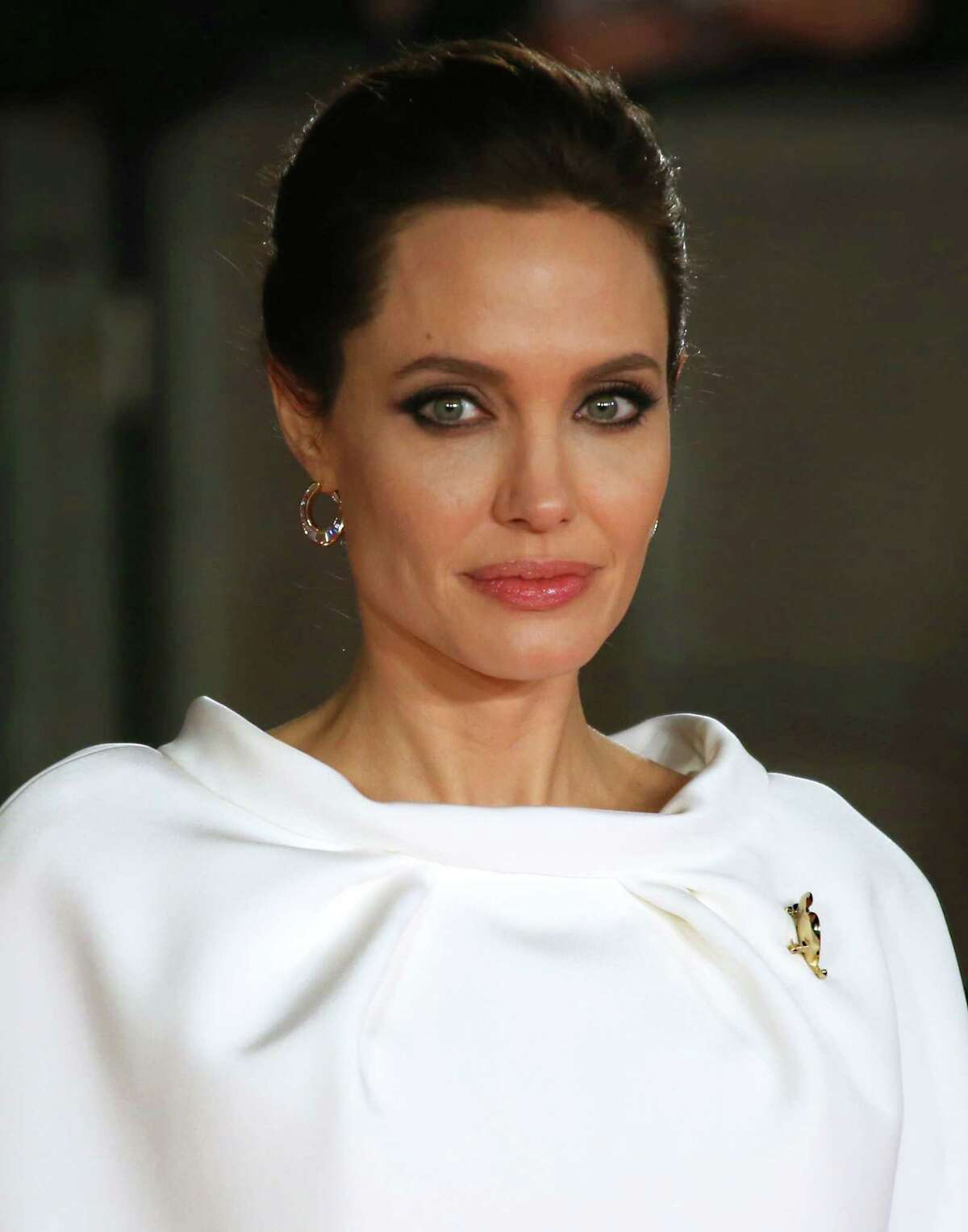 FILE - In this Nov. 25, 2014 file photo, director Angelina Jolie poses for photographers upon arrival at the premiere of the film