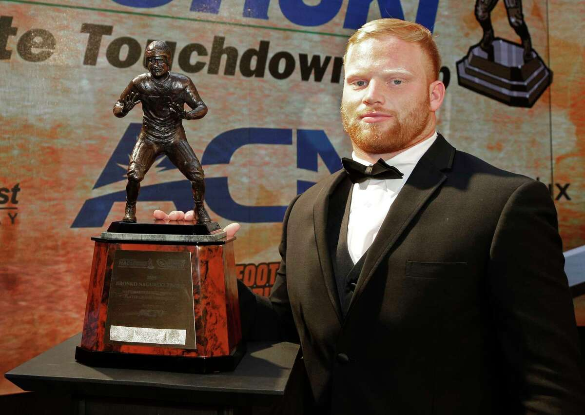 Temple's Tyler Matakevich poses with the Bronko Nagurski Award for the nation's top college football defensive player on Monday in Charlotte, N.C. Matakevich is a Stratford native and St. Joseph graduate.