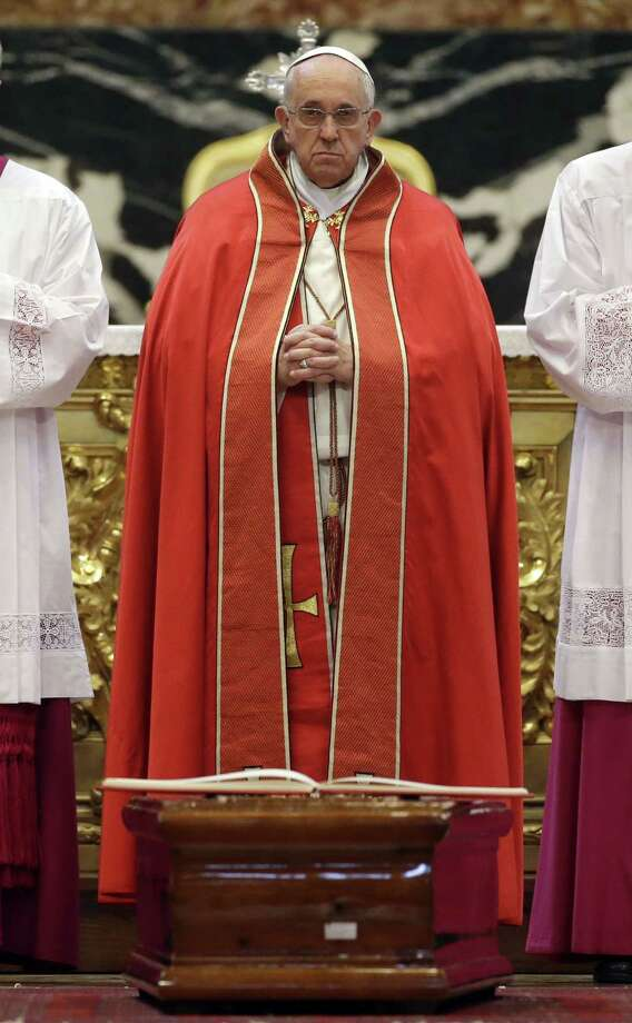 Pope Francis presides over a funeral ceremony for late Argentine Cardinal Jorge Maria Mejia, in St. Peter's Basilica, at the Vatican,  Thursday, Dec. 11, 2014. (AP Photo/Andrew Medichini) Photo: AP / AP