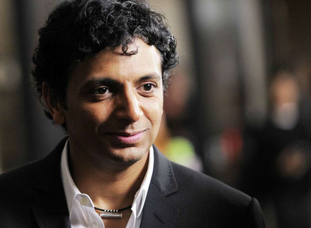 """FILE - In this Sept. 15, 2010 file photo, M. Night Shyamalan, producer of the film """"Devil,"""" arrives at the premiere of the film in West Hollywood, Calif. Shyamalanís former house manager Selma Nolan Cody pleaded guilty to a single count of theft by unlawful taking, reported Friday, Dec. 12, 2014. The third-degree felony carries a maximum penalty of seven years in prison. Sentencing is scheduled for Feb. 4.(AP Photo/Chris Pizzello)"""