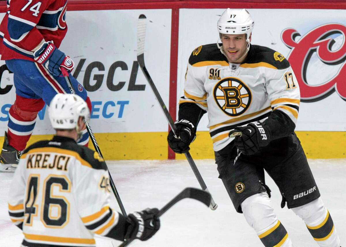 The Bruins' Milan Lucic, right, celebrates his goal against the Canadiens with teammate David Krejci during the second period of Boston's 4-1 win on Wednesday in Montreal.